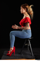Daisy Lee  1 blue jeans dressed red high heels red top sitting whole body 0009.jpg