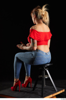 Daisy Lee  1 blue jeans dressed red high heels red top sitting whole body 0010.jpg