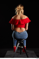 Daisy Lee  1 blue jeans dressed red high heels red top sitting whole body 0011.jpg