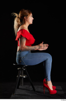 Daisy Lee  1 blue jeans dressed red high heels red top sitting whole body 0013.jpg