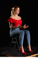 Daisy Lee  1 blue jeans dressed red high heels red top sitting whole body 0014.jpg