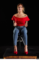 Daisy Lee  1 blue jeans dressed red high heels red top sitting whole body 0015.jpg