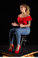 Daisy Lee  1 blue jeans dressed red high heels red top sitting whole body 0016.jpg