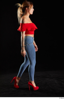 Daisy Lee  1 blue jeans dressed red high heels red top side view walking whole body 0002.jpg