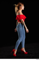 Daisy Lee  1 blue jeans dressed red high heels red top side view walking whole body 0005.jpg