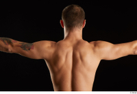 Anatoly  3 arm back view flexing nude upper body 0003.jpg