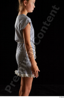 Isla  1 arm casual dress dressed flexing side view 0001.jpg