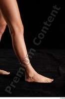 Isla  1 calf flexing nude side view 0004.jpg