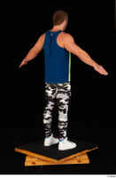 Herbert 10yers camo leggings dressed shoes sports standing tank top white sneakers whole body 0014.jpg