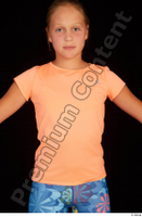 Esme dressed sports t shirt upper body 0001.jpg