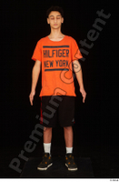 Danior black shorts black sneakers dressed orange t shirt shoes sports standing whole body 0001.jpg