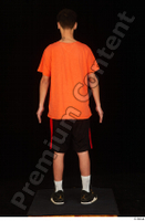 Danior black shorts black sneakers dressed orange t shirt shoes sports standing whole body 0005.jpg