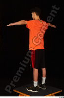 Danior black shorts black sneakers dressed orange t shirt shoes sports standing t poses whole body 0004.jpg