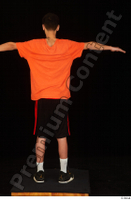 Danior black shorts black sneakers dressed orange t shirt shoes sports standing t poses whole body 0005.jpg