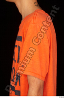 Danior arm dressed orange t shirt shoulder sports upper body 0001.jpg