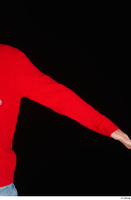 Ricky Rascal arm casual dressed red sweater upper body 0002.jpg