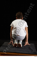 Duke  1 dressed jogging suit kneeling sneakers sports sweatsuit t shirt whole body 0005.jpg
