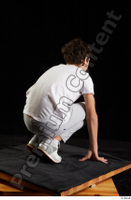 Duke  1 dressed jogging suit kneeling sneakers sports sweatsuit t shirt whole body 0006.jpg