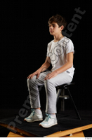 Duke  1 dressed jogging suit kneeling sneakers sports sweatsuit t shirt whole body 0016.jpg