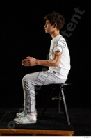 Duke  1 dressed jogging suit kneeling sneakers sports sweatsuit t shirt whole body 0017.jpg