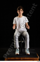 Duke  1 dressed jogging suit kneeling sneakers sports sweatsuit t shirt whole body 0023.jpg