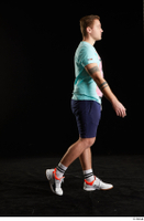 Albin  1 dressed shoes shorts side view sneakers sports t shirt walking whole body 0005.jpg