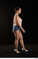 Sofia Lee  1 casual dressed high heels jeans shorts side view tank top walking whole body 0004.jpg