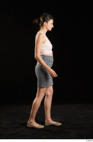 Tiny Tina  1 ballerina shoes dressed grey skirt pink top side view walking whole body 0004.jpg