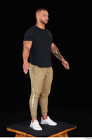 Grigory black t shirt brown sweatpants dressed sports standing white sneakers whole body 0016.jpg