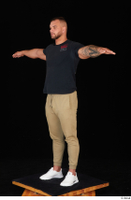 Grigory black t shirt brown sweatpants dressed sports standing t poses white sneakers whole body 0002.jpg