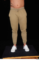 Grigory brown sweatpants dressed leg lower body sports white sneakers 0001.jpg