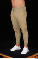 Grigory brown sweatpants dressed leg lower body sports white sneakers 0002.jpg