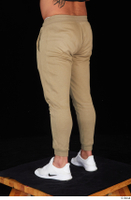 Grigory brown sweatpants dressed leg lower body sports white sneakers 0004.jpg