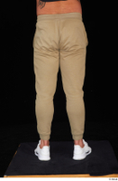 Grigory brown sweatpants dressed leg lower body sports white sneakers 0005.jpg
