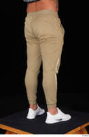 Grigory brown sweatpants dressed leg lower body sports white sneakers 0006.jpg