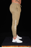 Grigory brown sweatpants dressed leg lower body sports white sneakers 0007.jpg