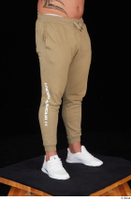 Grigory brown sweatpants dressed leg lower body sports white sneakers 0008.jpg