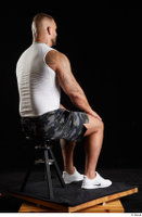 Grigory  1 camo shorts dressed sitting sports white sneakers white tank top whole body 0004.jpg
