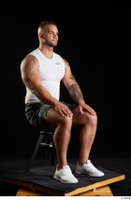 Grigory  1 camo shorts dressed sitting sports white sneakers white tank top whole body 0006.jpg