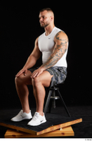 Grigory  1 camo shorts dressed sitting sports white sneakers white tank top whole body 0008.jpg