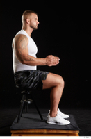 Grigory  1 camo shorts dressed sitting sports white sneakers white tank top whole body 0013.jpg