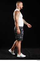 Grigory  1 camo shorts dressed side view sports walking white sneakers white tank top whole body 0002.jpg
