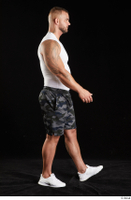 Grigory  1 camo shorts dressed side view sports walking white sneakers white tank top whole body 0004.jpg