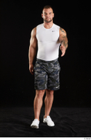 Grigory  1 camo shorts front view sports walking white sneakers white tank top whole body 0001.jpg