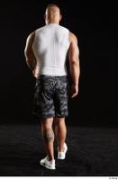 Grigory  1 back view camo shorts dressed sports walking white sneakers white tank top whole body 0001.jpg