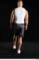 Grigory  1 back view camo shorts dressed sports walking white sneakers white tank top whole body 0003.jpg