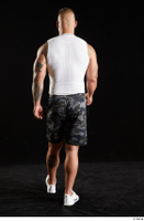 Grigory  1 back view camo shorts dressed sports walking white sneakers white tank top whole body 0004.jpg