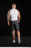 Grigory  1 back view camo shorts dressed sports walking white sneakers white tank top whole body 0005.jpg