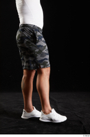 Grigory  1 camo shorts dressed flexing leg side view sports white sneakers 0002.jpg