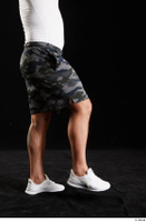 Grigory  1 camo shorts dressed flexing leg side view sports white sneakers 0003.jpg